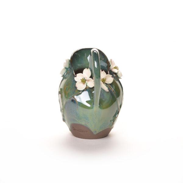ceramic handmade pitcher with green glaze and white dogwood flowers