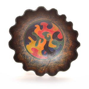 hand tooled and hand dyed leather bowl with puzzle design in the middle, ruffle edged leather bowl, wet formed leather