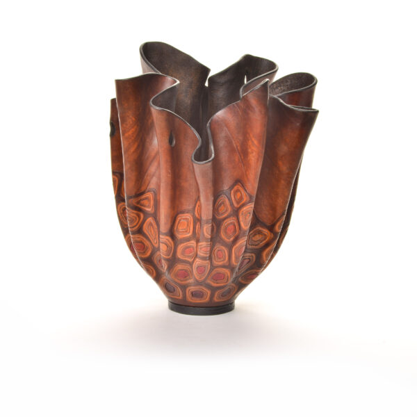 carved and colored leather sculpture with turtle shell decoration