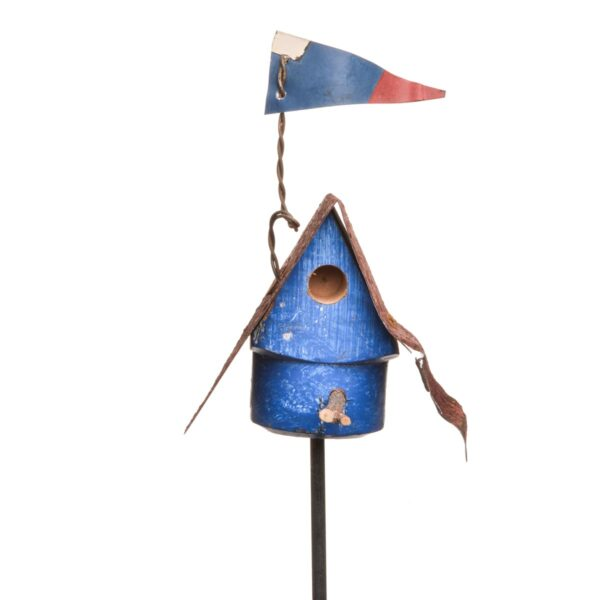 blue handmade wooden garden stake with repurposed wood and a rusty roof and flag, birdhouse garden stake