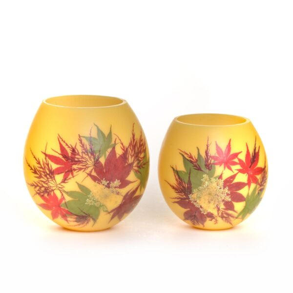 red and green maple leaves on beeswax handmade lantern