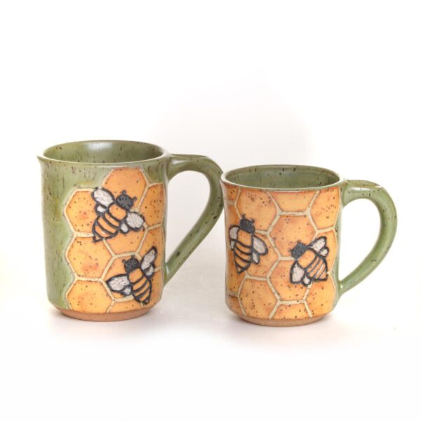 handmade carved bee ceramic mug, bees and honeycomb carved in a green ceramic mug