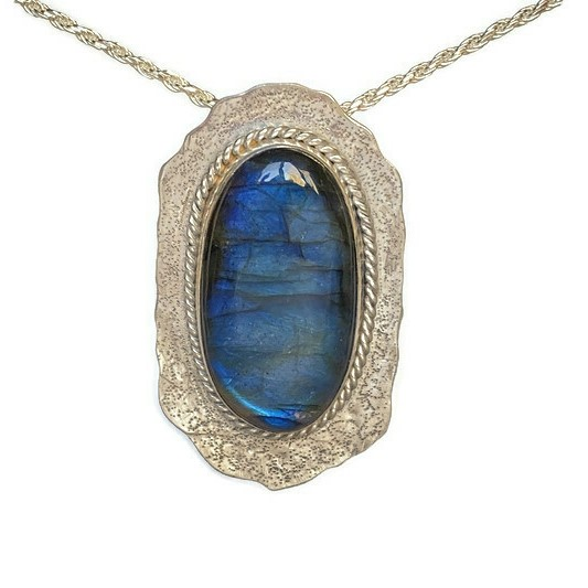 large oval labradorite stone set in sterling silver