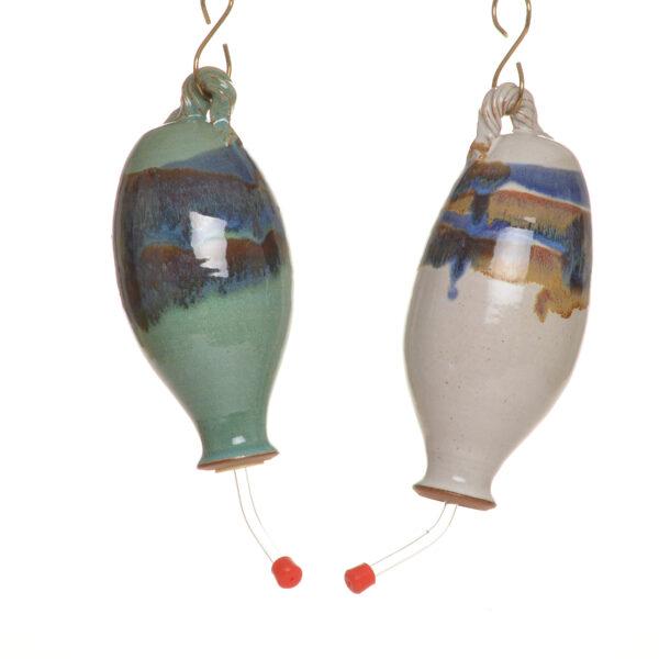 handmade ceramic hummingbird feeders in green and white
