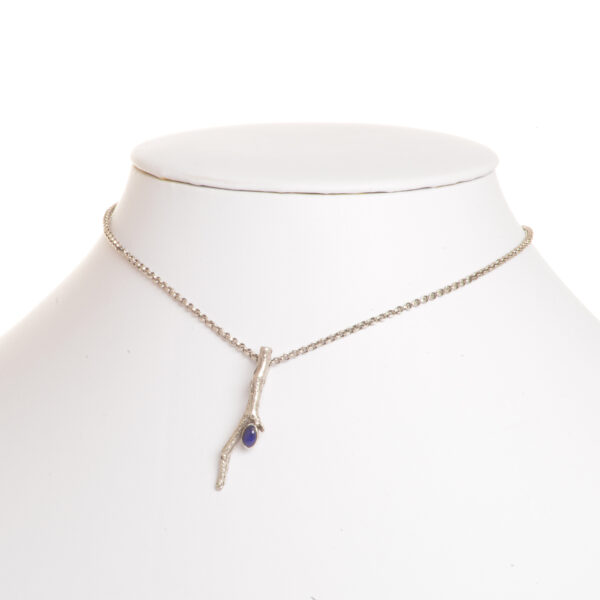 handmade cast silver twig pendant with small oval lapis lazuli on silver chain