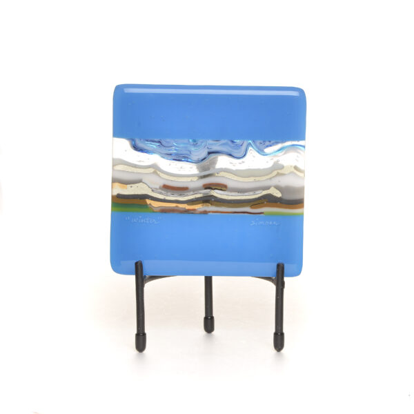 winter fused glass landscape tile with bright blue border