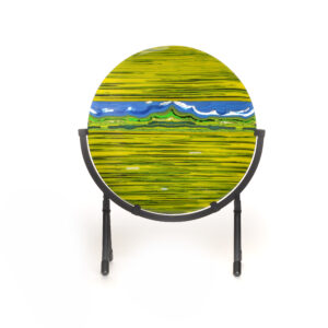 green and blue mountain landscape in a disk with black stand, fused glass landscape