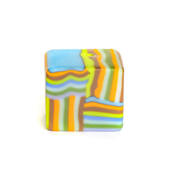 blue green and orange fused glass paperweight