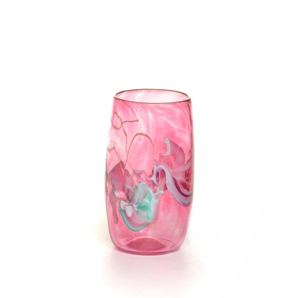 transparent pink handmade blown glass cup with colorful swirls