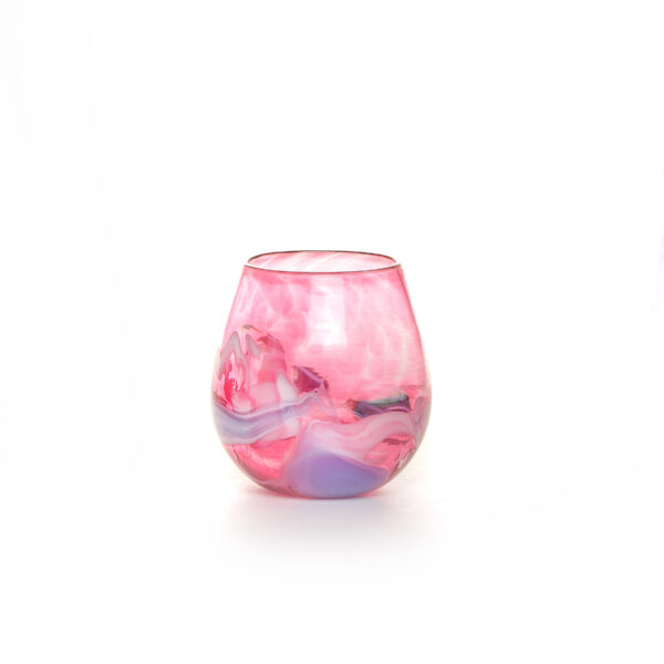 colorful pink handmade blown glass stemless wine glass with color swirls