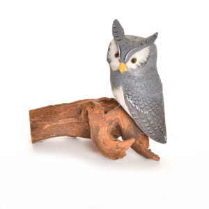 carved and painted small gray owl on piece of wood