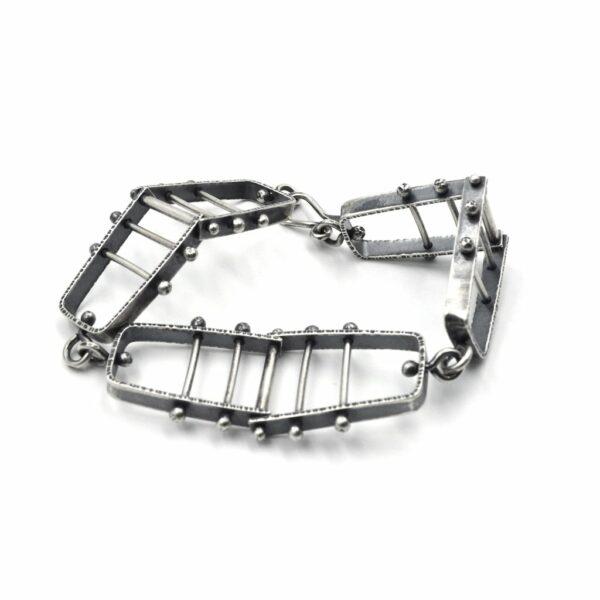 forged sterling silver oxidized kinetic bracelet, asheville jeweler