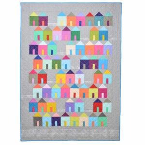 neighborhood quilt with gray border and rainbow houses