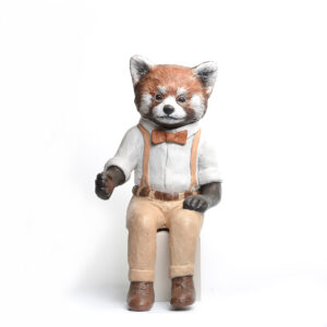 painted clay sculpture of a red panda dressed up in pants and suspenders