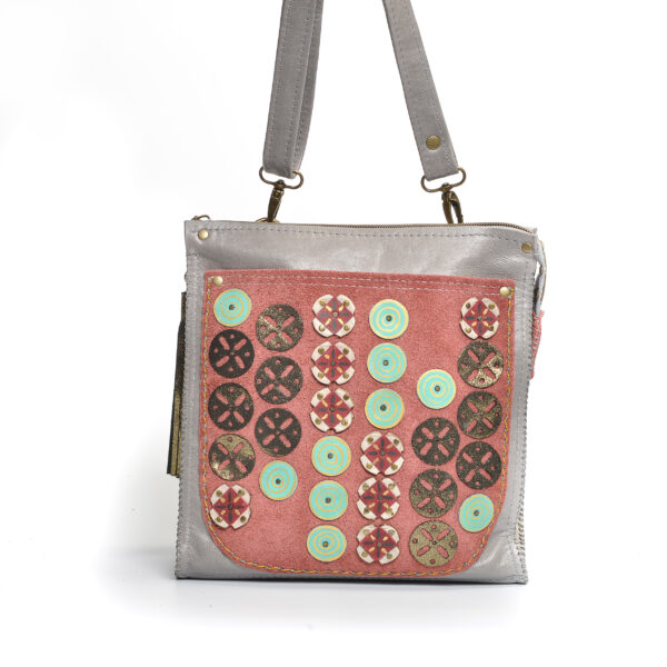large handmade gray crossbody bag with coral front pocket and circle pattern