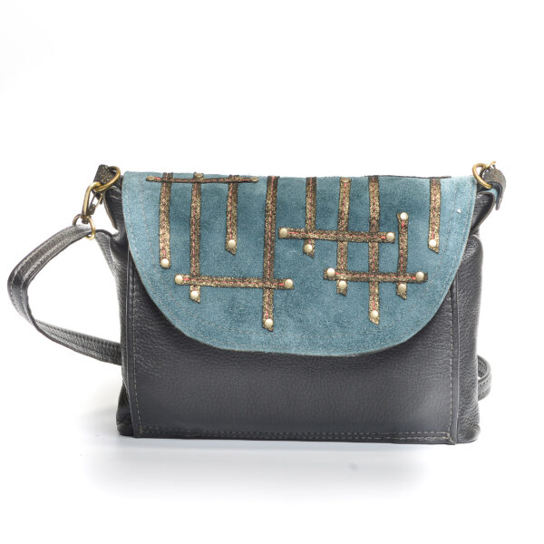 dark leather bag with blue flap and line pattern,