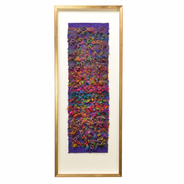 handmade loopy wall hanging in a rainbow of colors