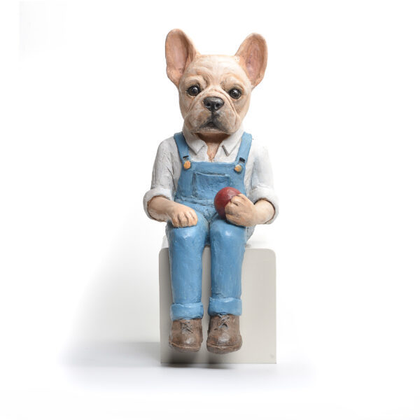 bulldog in overalls sitting, holding an apple, ceramic dog sculpture