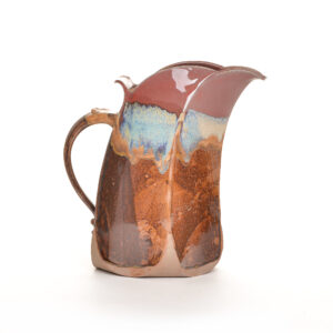 red and brown handmade ceramic pitcher