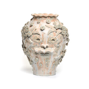 handmade ceramic vase with face and flowers
