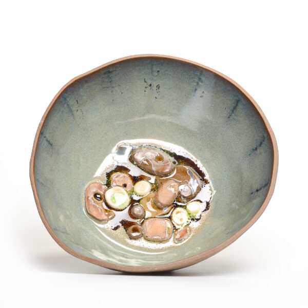 inside view of a large bowl with stones like the bottom of a riverbed