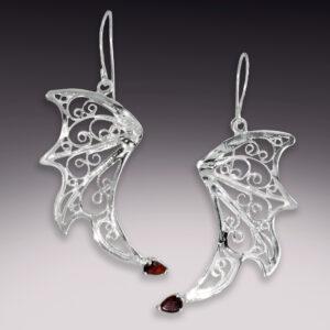 silver filigree dragon wing earrings with garnet gemstones