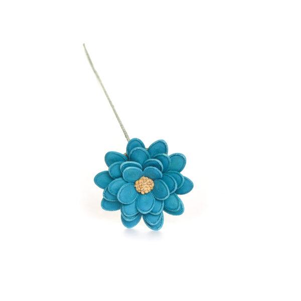 light blue flower made using dyed pumpkin seeds and sesame seeds
