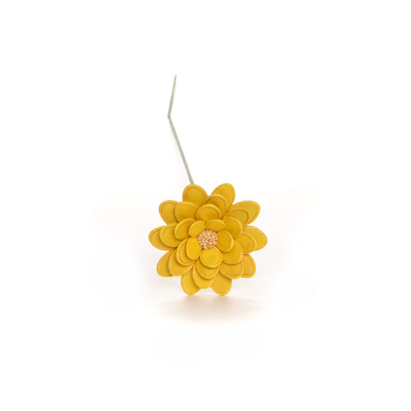 yellow flower made using dyed pumpkin seeds and sesame seeds