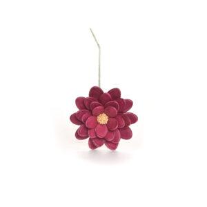 large dark pink flower made using pumpkin and sesame seeds