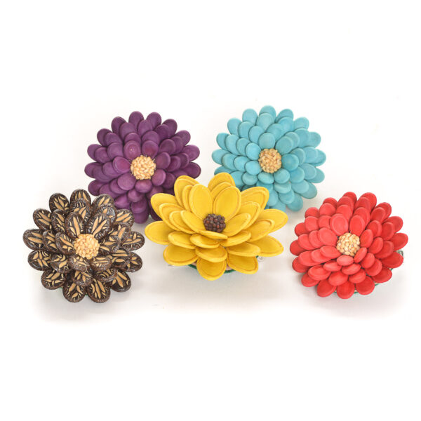 colorful pins made using dyed seeds