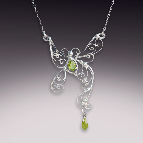 silver filigree butterfly necklace with peridot