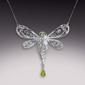silver dragonfly filigree necklace with peridot