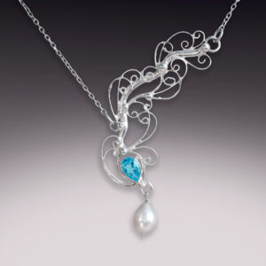 silver handmade filigree necklace with blue topaz and pearls