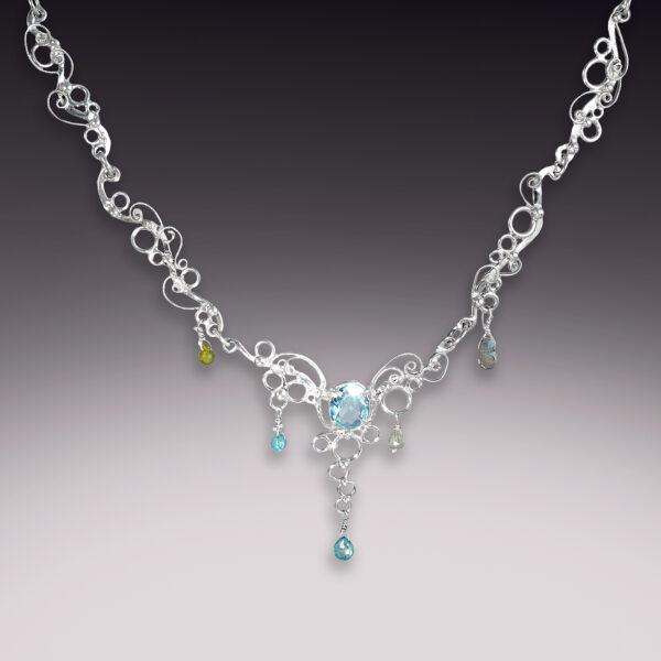 handmade filigree silver necklace wtih blue topaz and labradorite