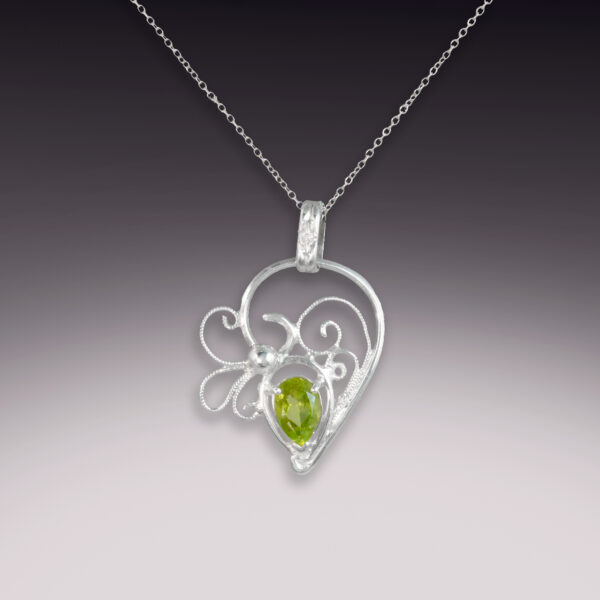 silver handmade filigree pendant with peridot