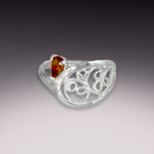 silver filigree ring with golden tourmaline