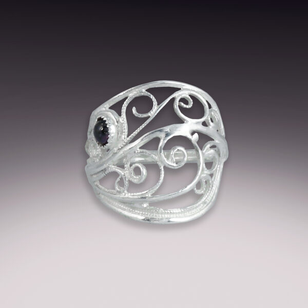 filigree silver handmade ring with garnet stone