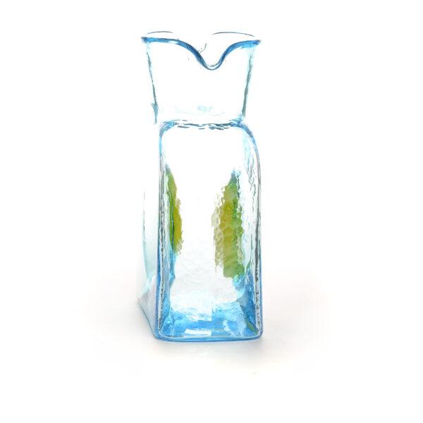 light blue handmade glass water bottle with yellow dot