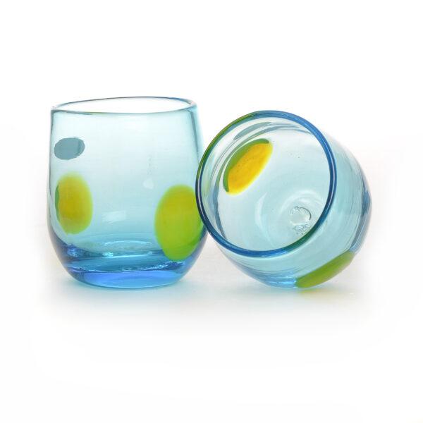 light blue handmade glass cup with yellow dot