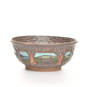 medium carved ceramic serving bowl with bear and mountains