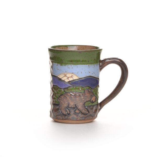handmade ceramic carved mug with bear and mountains