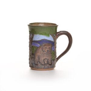 wheel thrown ceramic mug with bear and mountains.