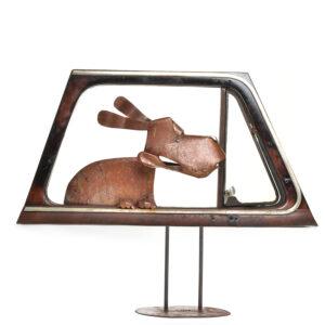 dog in car window sculpture, folk art center