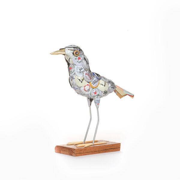 bird sculpture made using beer bottle caps