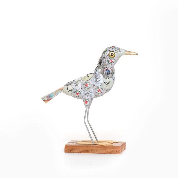 white found object bird sculpture, beer bottle cap bird sculpture