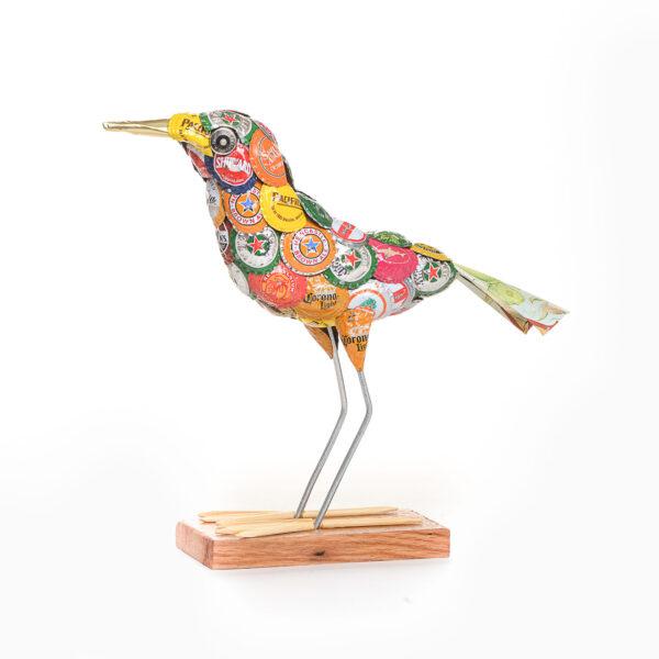 bird sculpture made using beer bottle lids