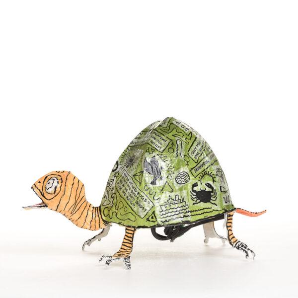 handmade papermache turtle dim light,
