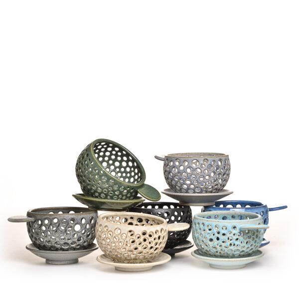 assorted handmade ceramic berry bowls