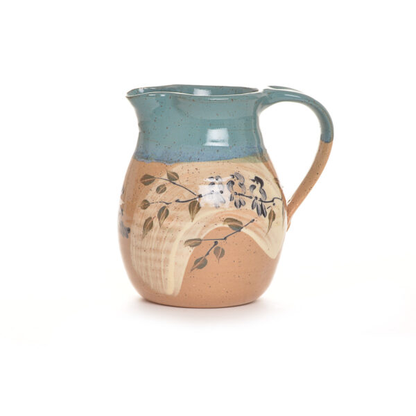 handmade clay pitcher with hand painted bluebirds