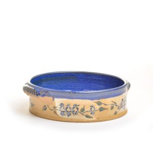 Wheel thrown handled baking dish with hand painted birds and a beautiful blue glaze by artist Ann Gleason.